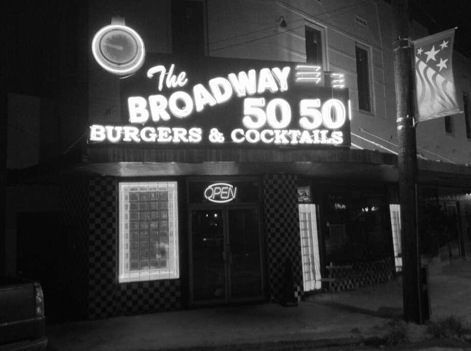 The neon glow of the Broadway 5050 has helped give the Alamo Heights establishment landmark status. Photo: Robert Kolarik, San Antonio Express-News