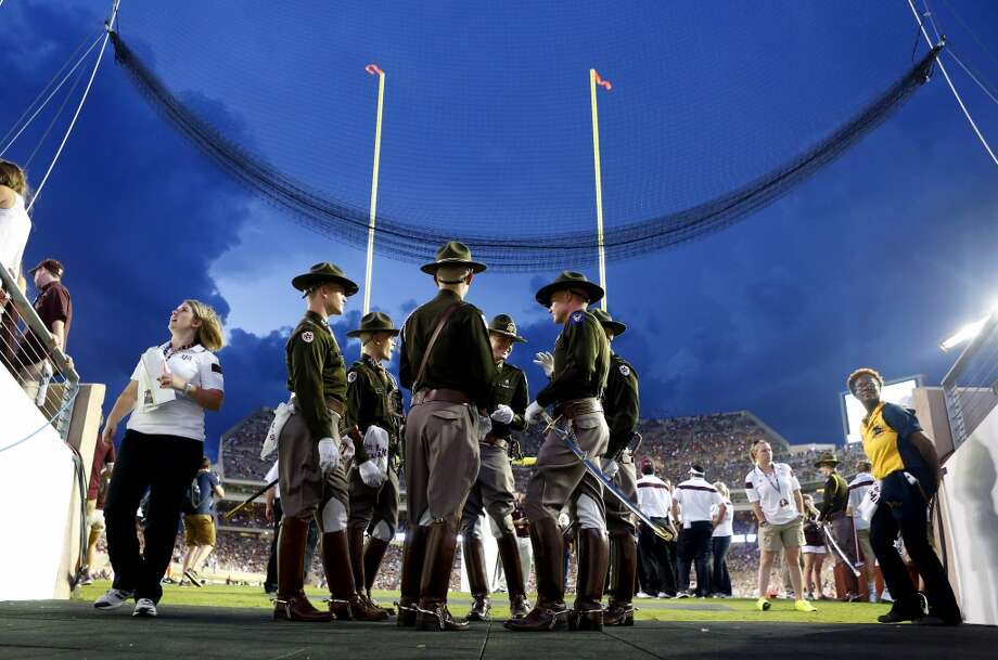 The Texas A&M Corps of Cadets wait during after an NCAA college football game against the Lamar Cardinals was delayed due to lightning at Kyle Field, Saturday, Sept. 6, 2014, in College Station. (Cody Duty / Houston Chronicle) Photo: Cody Duty, Houston Chronicle