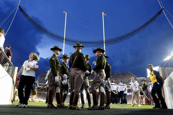 The Texas A&M Corps of Cadets wait during after an NCAA college football game against the Lamar Cardinals was delayed due to lightning at Kyle Field, Saturday, Sept. 6, 2014, in College Station. (Cody Duty / Houston Chronicle)