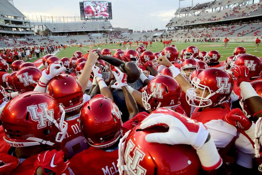 The Houston Cougars team huddle before plying against the Grambling State Tigers on September 6, 2014 at John O'Quinn Field at TDECU Stadium in Houston, TX. (Photo: Thomas B. Shea/For the Chronicle) Photo: Thomas B. Shea, For The Chronicle