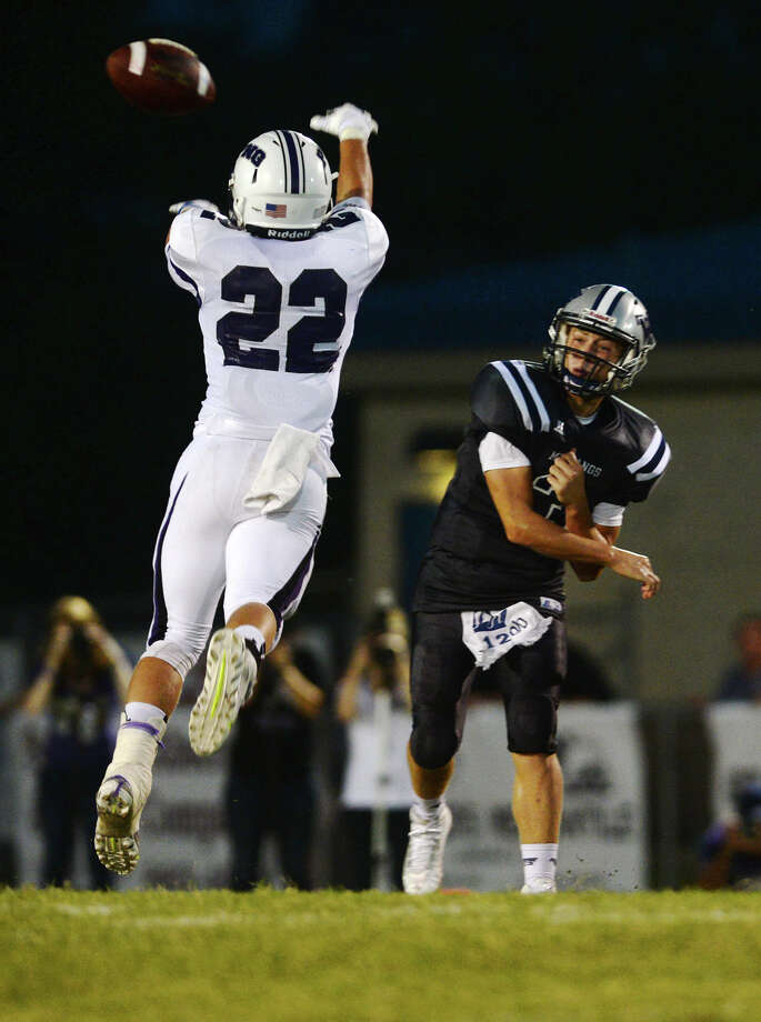 The Indians' Michael Hughes, No. 22, fouls up a pass by Mustangs quarterback Jackson Dallas, No. 3, during Friday's game. The West Orange-Stark Mustangs hosted the Port Neches-Groves Indians on Friday night.  Photo taken Friday 9/5/14  Jake Daniels/@JakeD_in_SETX Photo: Jake Daniels / ©2014 The Beaumont Enterprise/Jake Daniels