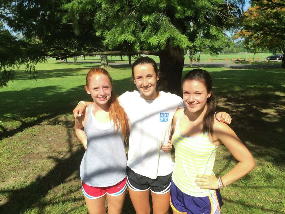 From left, the 2014 New Canaan girls cross country captains Lily Baer, Emma Rosenstein and Corrine Vietorisz. Photo: Andrew Callahan / New Canaan News