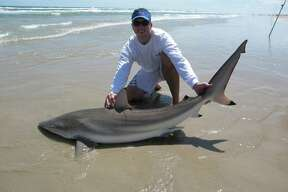 Rick Underbrink and a 76 inch Spinner Shark he caught at Padres Island National Seashore.