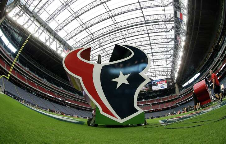 In a photo taken with a fisheye lens, the Texans logo is seen at NRG Stadium before an NFL football game between the Houston Texans and Washington Redskins, Sunday, Sept. 7, 2014, in Houston. (AP Photo/David J. Phillip)