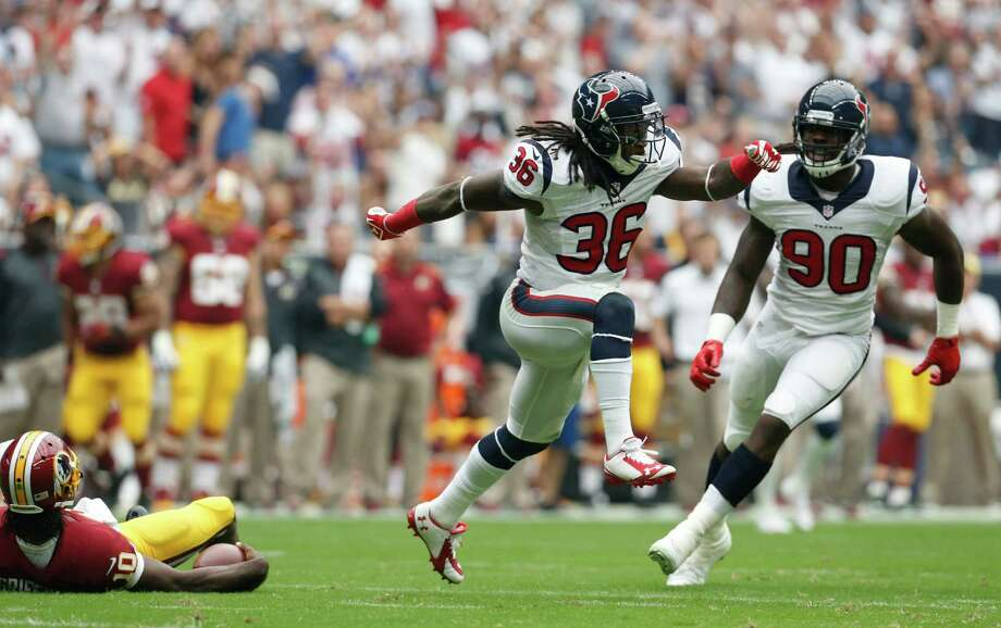 Houston Texans strong safety D.J. Swearinger (36) celebrates with linebacker Jadeveon Clowney (90) after sacking Washington Redskins quarterback Robert Griffin III (10) during the first quarter of an NFL football game at NRG Stadium, Sunday, Sept. 7, 2014, in Houston. Photo: Karen Warren, Houston Chronicle / © 2014 Houston Chronicle