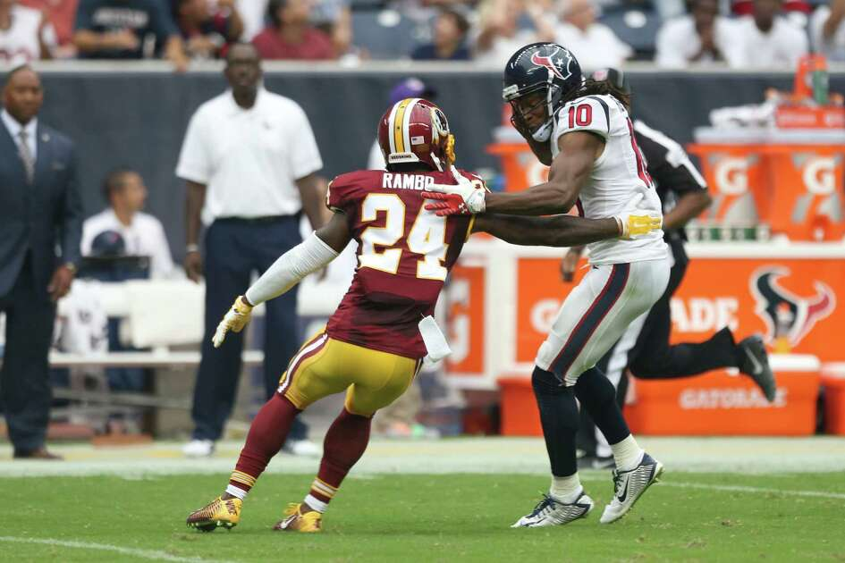 Houston Texans wide receiver DeAndre Hopkins (10) gets past Washington Redskins strong safety Bacarri Rambo (24) on a 76-yard touchdown reception during the second quarter of an NFL football game at NRG Stadium on Sunday, Sept. 7, 2014, in Houston.