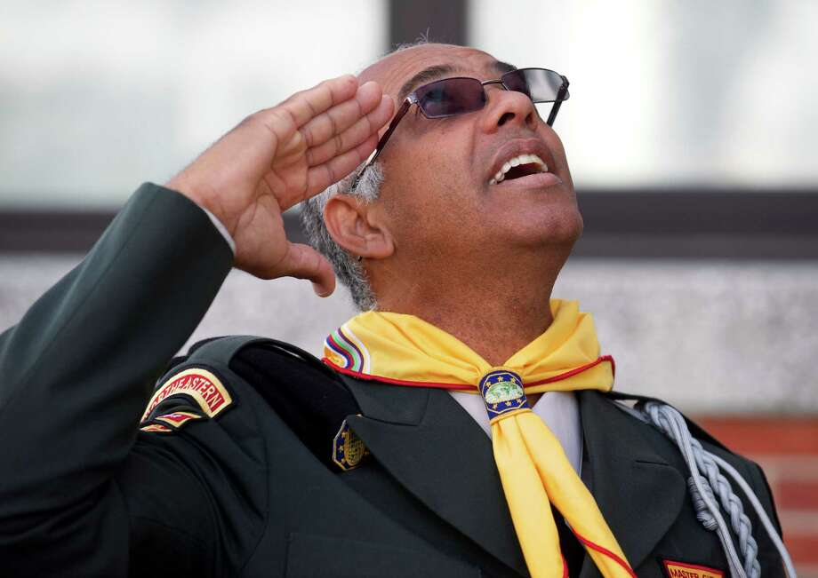 Pastor Luiz Herique Souza, 54, of Danbury, salutes the during the 15th annual Brazilian flag raising ceremony, held at Danbury City Hall, Danbury, Conn, on Sunday, September, 7, 2014. He is a member of Pathfinders and Adventurers Universal in Danbury. Photo: H John Voorhees III / The News-Times Freelance