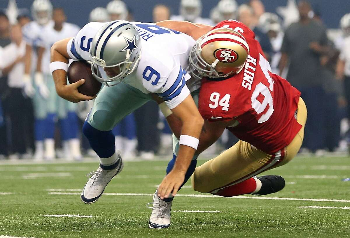 ARLINGTON, TX - SEPTEMBER 07: Tony Romo #9 of the Dallas Cowboys is sacked by Justin Smith #94 of the San Francisco 49ers in the first half at AT&T Stadium on September 7, 2014 in Arlington, Texas. (Photo by Christian Petersen/Getty Images)