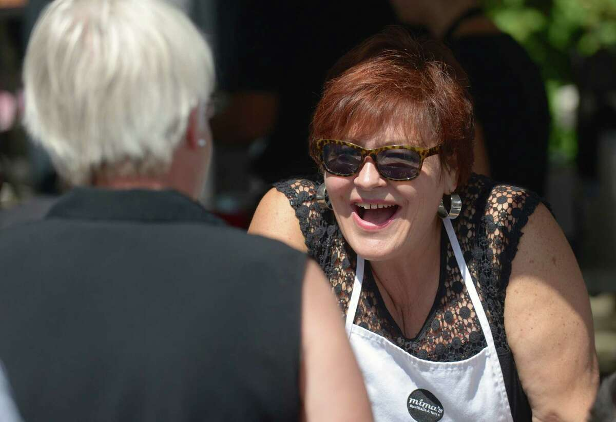 Patti Hunt, of Danbury, an owner of Mima's Meatballs & More, in Danbury, takes an order at their stand during the Taste of Greater Danbury, on Sunday, September 7, 2014, in Danbury, Conn.