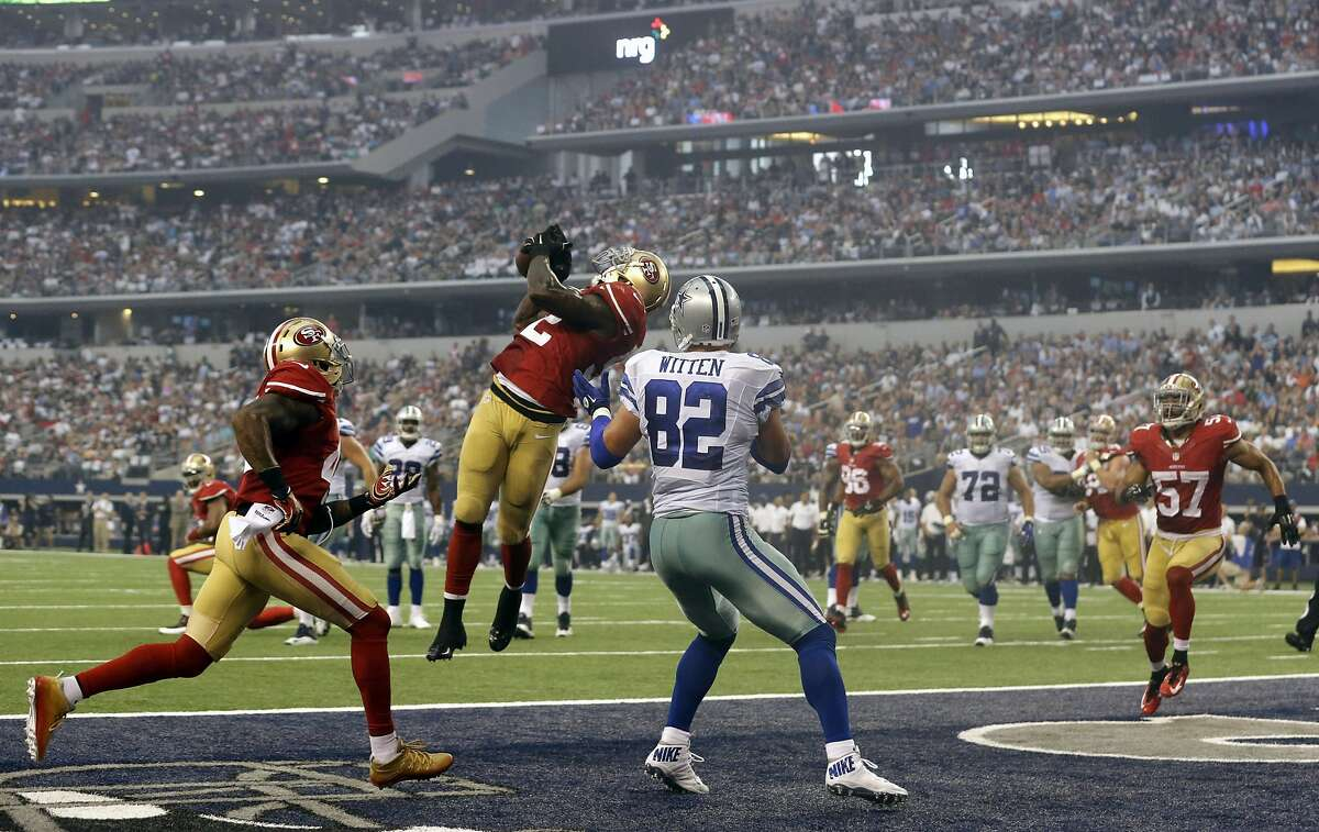 San Francisco 49ers inside linebacker Patrick Willis, second from left, intercepts a pass intended for Dallas Cowboys tight end Jason Witten (82) in the end zone during the first half of an NFL football game, Sunday, Sept. 7, 2014, in Arlington, Texas. (AP Photo/LM Otero)