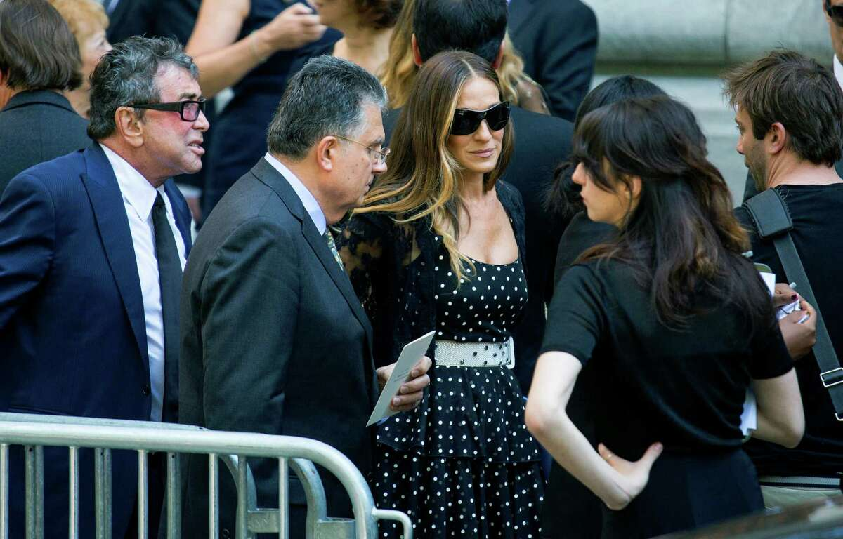 Sarah Jessica Parker, center right, speaks with attendees after a funeral service for comedian Joan Rivers at Temple Emanu-El in New York Sunday, Sept. 7, 2014. Rivers died Thursday at 81.