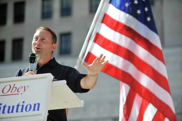 Republican gubernatorial candidate Rob Astorino addresses his supporters during a rally at West Capitol Park on Sunday, Sept. 7, 2014, in Albany, N.Y.  (Paul Buckowski / Times Union) Photo: Paul Buckowski / 00028470A