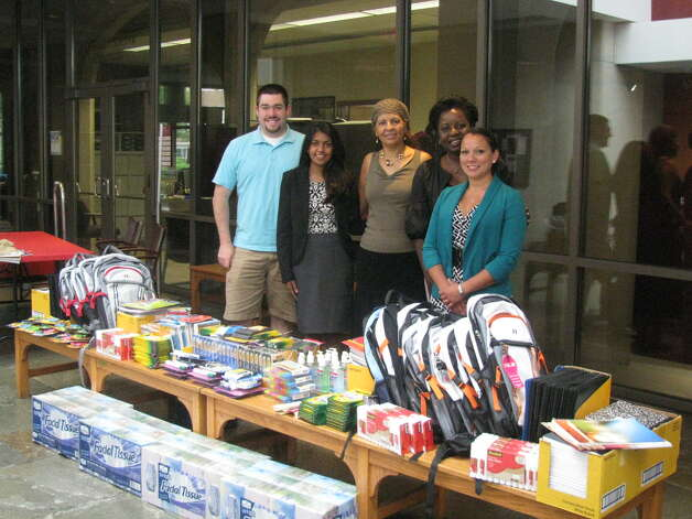 Albany Law School students, faculty and staff raised more than $1,000 to buy supplies for more than 20 refugee children who started attending Albany city schools last week. From left, Kevin Murphy (Class of 2016); Princy Abraham '15, project leader for the Immigration Assistance Pro Bono Project; President & Dean Penelope (Penny) Andrews; Pershia Wilkins, assistant director of admissions and director of multicultural initiatives; and Nic Rangel '12, post-graduate pro bono fellow. (Nick Crounse)