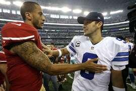 San Francisco 49ers quarterback Colin Kaepernick and Dallas Cowboys quarterback Tony Romo greet each other after their NFL football game, Sunday, Sept. 7, 2014, in Arlington, Texas. San Francisco won 28-17. (AP Photo/LM Otero)