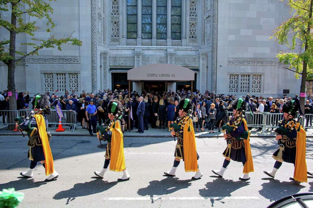 Bagpipers march from the funeral service for comedian Joan Rivers at Temple Emanu-El in New York Sunday, Sept. 7, 2014. Rivers died Thursday at 81. (AP Photo/Craig Ruttle)