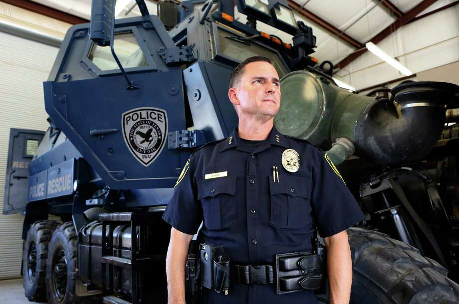 City of Live Oak Police Chief Ken Evans looks at the police department's military surplus MRAP which will be part of Alamo Area Metro SWAT.  The vehicle is currently waiting on parts for a repair in the city's garage.  Friday, Aug. 5, 2014. Photo: Bob Owen, San Antonio Express-News / ©2013 San Antonio Express-News