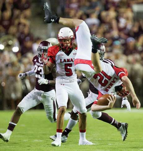 As expected, Lamar's Caleb Berry and his teammates suffered a hard landing Saturday night at A&M. Photo: Cody Duty, Staff / © 2014 Houston Chronicle