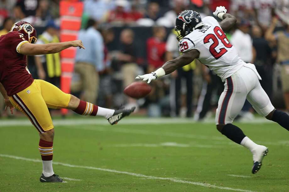 Sunday turned out to be special for Texans rookie Alfred Blue (28), who blocked Tress Way's punt and then scooped up the ball to score a touchdown in the second quarter of the season-opening win over Washington. Photo: Brett Coomer, Staff / © 2014  Houston Chronicle