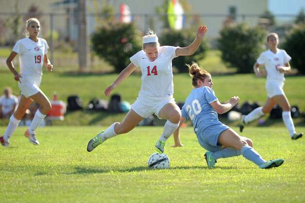 Guilderland's Karly Meacham, center, battles for the ball against Columbia's Emily Lewandusky during their soccer game on  Thursday, Sept. 4, 2014, at Guilderland High in Guilderland, N.Y. (Cindy Schultz / Times Union) Photo: Cindy Schultz / 00028463A