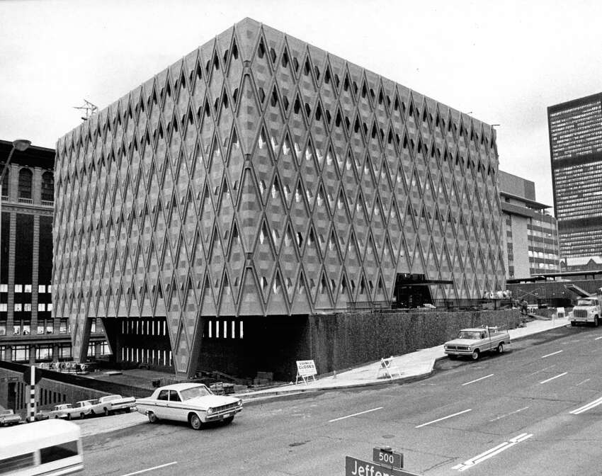 The King County Administration Building, pictured in the '70s, could easily be mistaken for the county jail - it's so grim-looking. Monochromatic colors don't help, with soulless taupe rising above, and ...