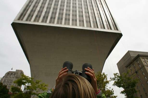 """Rainier Tower:  Architecture critic Lawrence Cheek called this 31-story skyscraper a """"horrifying megahulk"""" that provokes """"instinctive discomfort."""" Its wineglass-stem shape was probably an engineering marvel when it was built in 1977. At 1301 Fifth Ave."""