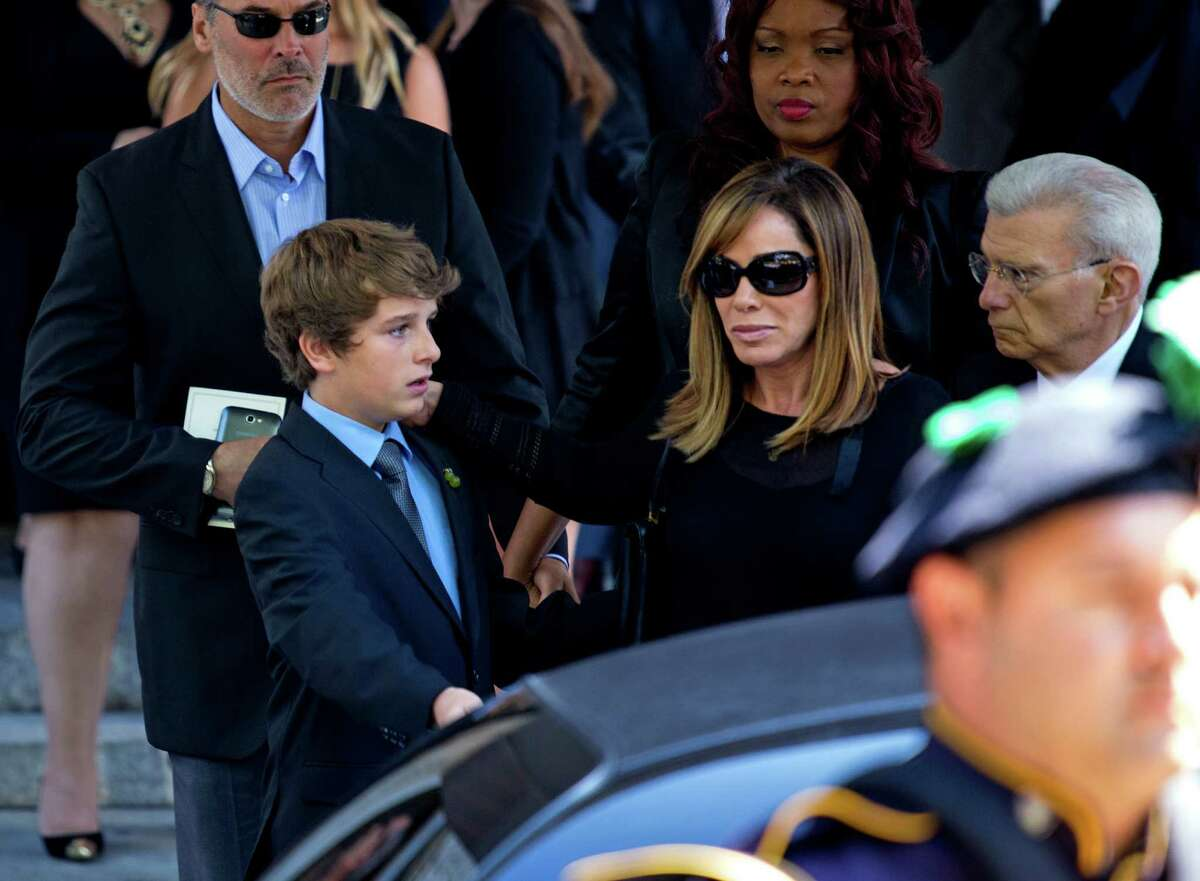 Melissa Rivers and her son Cooper Endicott walk to a waiting car after the funeral service for comedian Joan Rivers at Temple Emanu-El in New York Sunday, Sept. 7, 2014. Rivers died Thursday at 81. (AP Photo/Craig Ruttle) ORG XMIT: NYCR127