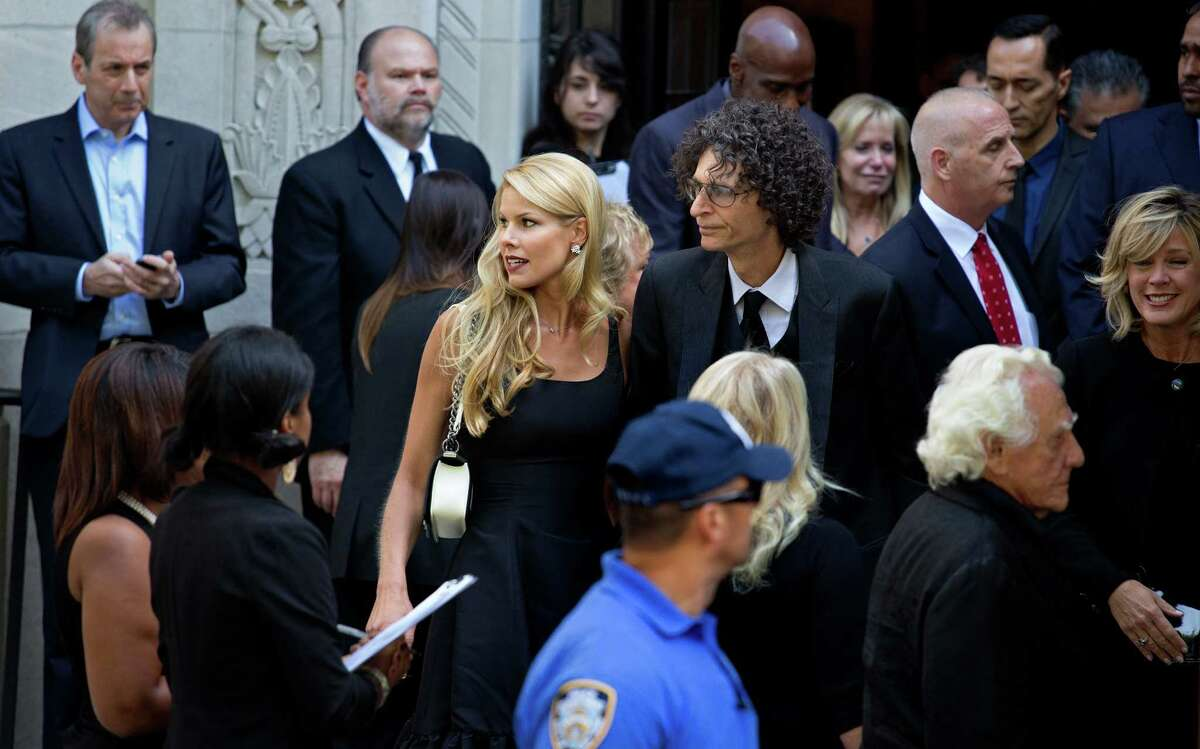 Howard Stern, center right, and his wife Beth depart a funeral service for comedian Joan Rivers at Temple Emanu-El in New York Sunday, Sept. 7, 2014. Rivers died Thursday at 81. (AP Photo/Craig Ruttle) ORG XMIT: NYCR121