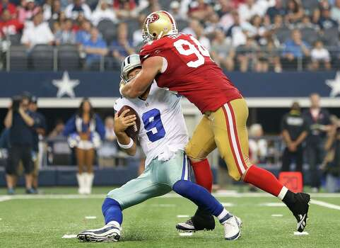 ARLINGTON, TX - SEPTEMBER 07: Tony Romo #9 of the Dallas Cowboys is sacked by Justin Smith #94 of the San Francisco 49ers in the second half at AT&T Stadium on September 7, 2014 in Arlington, Texas. (Photo by Christian Petersen/Getty Images) Photo: Getty Images / 2014 Getty Images
