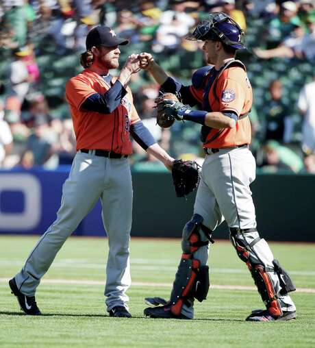Josh Fields, left, celebrates with catcher Jason Castro after serving as the Astros closer for Sunday's victory. Photo: Marcio Jose Sanchez, STF / AP