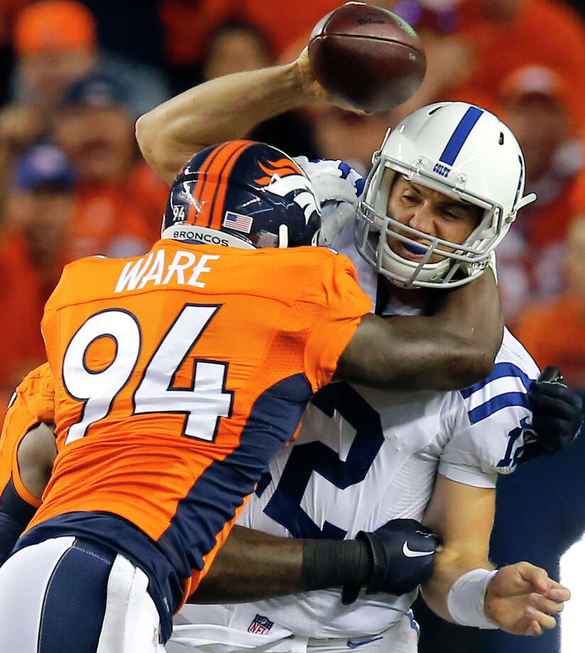 Indianapolis Colts quarterback Andrew Luck (12) is sacked by Denver Broncos defensive end DeMarcus Ware (94) during the first half of an NFL football game, Sunday, Sept. 7, 2014, in Denver. (AP Photo/Jack Dempsey) Photo: Jack Dempsey, Associated Press / FR42408 AP
