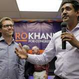 Ro Khanna, right, addresses supporters gathered at a new campaign center for the democratic challenger as he is joined on stage by Jeremy Bird, left, in Cupertino, Calif., on Tuesday night, April 22, 2014.