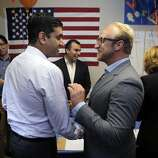 William Rinehart, right, field director for Ro Khanna's campaign, greets Khanna as he arrives to meet supporters at a new campaign center for the democratic challenger in Cupertino, Calif., on Tuesday night, April 22, 2014. Khanna addressed volunteers who are trying to help him unseat incumbent Mike Honda, who has served 7 terms.