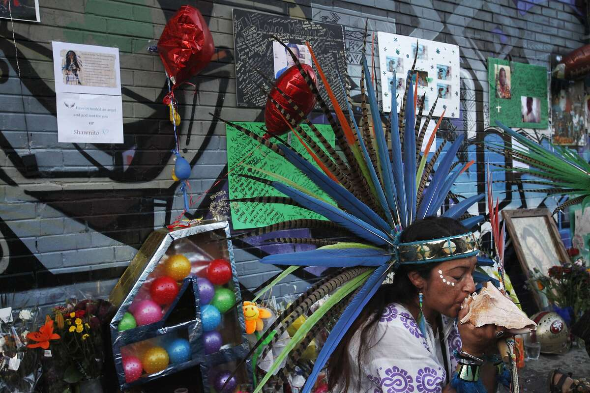 Xavela Vargas takes part in a traditional Aztec dance for Williams' spirit during a vigil held in honor of Rashawn Williams, 14, at the corner where he was stabbed to death last week on 26th and Folsom Sept. 7, 2014 in San Francisco, Calif.