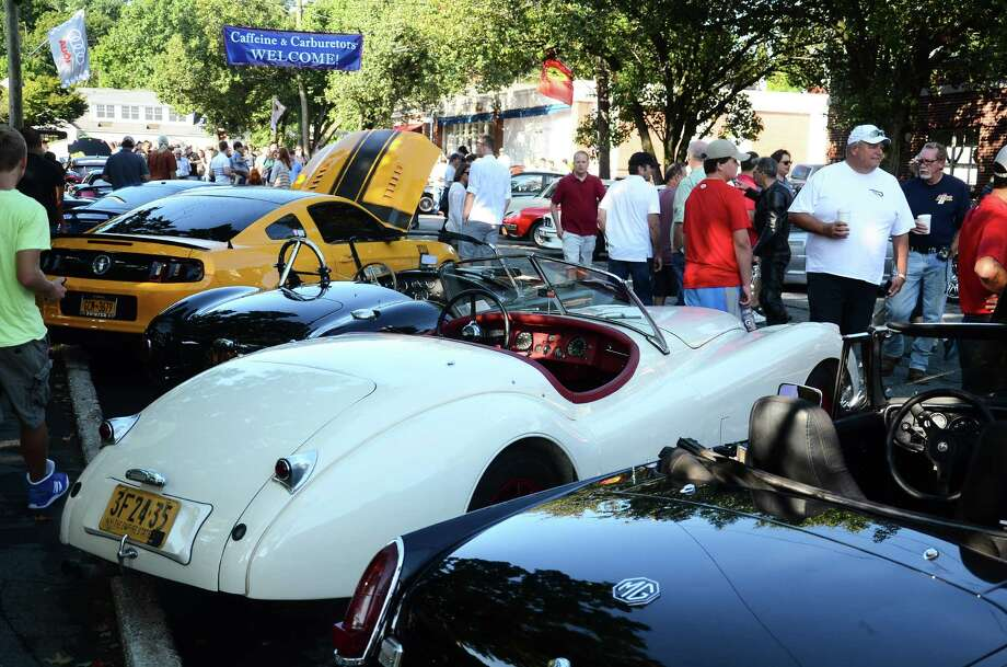 Several hundred people walk on Pine Street in New Canaan, Conn., during the Caffeine & Carburetors car show, Sunday, Sept. 2014. Photo: Nelson Oliveira / New Canaan News