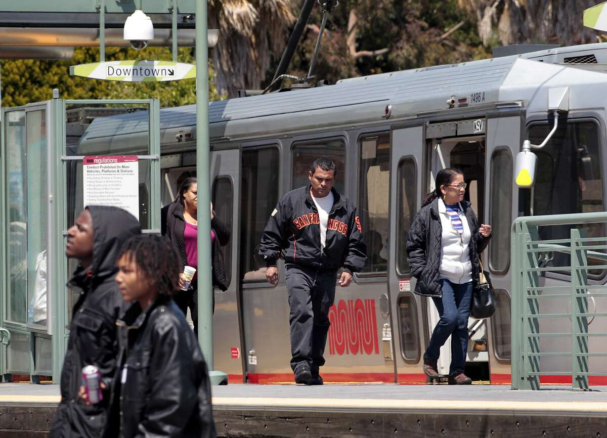 People commute on the new rail line along Third Street in the Bayview District, Sunday May 29, 2011, in San Francisco, Calif. The new Muni line was meant the bring vitality to the area but it hasn't done so and some merchants feel the city has forgotten them when it comes to redevelopment.