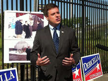 Republican Dan Debicella, who is challenging Democratic Congressman Jim Himes, holds a campaign press conference Monday outside of the shuttered Derecktor Shipyards.