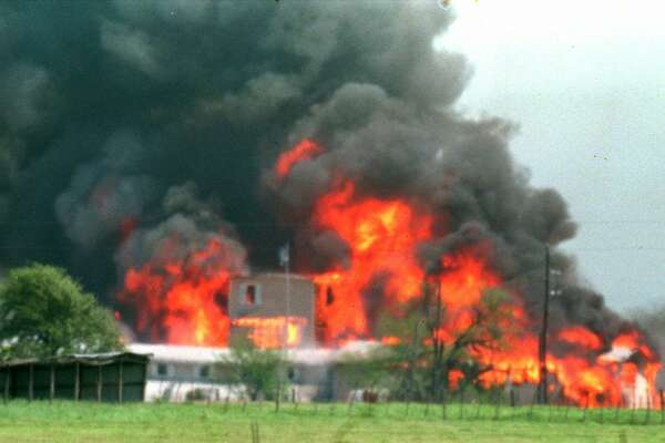 Fire engulfs the Branch Davidian compound near Waco, Texas, April 19, 1993. Eighty-one Davidians, including leader David Koresh, perished as federal agents tried to drive them out of the compound. A few weeks earlier four agents from  the Bureau of Alcohol, Tobacco and Firearms were slain in a shootout at the site, and six cult members were found dead inside.  (AP Photo/Ron Heflin, File)