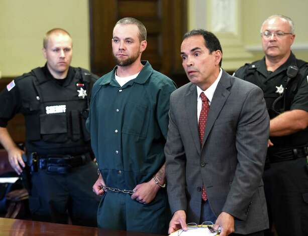 Daniel P. Reuter, left, stands with his attorney, Jay Hernandez, while his is arraigned on murder charges Monday morning, Sept. 8, 2014, in Rensselaer County Court in Troy, N.Y.   (Skip Dickstein/Times Union) Photo: SKIP DICKSTEIN / 00028502A