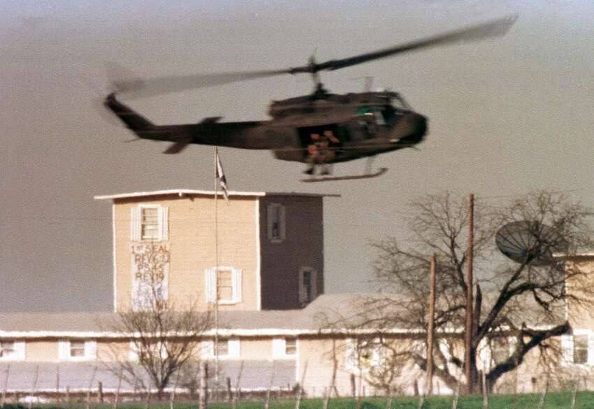 A helicopter makes a low pass over the Branch Davidian compound near Waco, Texas in this April 9, 1993 file photo. It's been seven years since 80 people died in the fiery conclusion to a standoff between the government and the Branch Davidian religious sect. Family members and survivors are seeking $675 million in the wrongful death suit, which consolidates nine civil cases filed in 1994, Sunday, June 11, 2000, in Waco, Texas. (AP Photo/David Phillip, File)