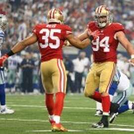 Eric Reid and Justin Smith both stood tall in Dallas (Christian Petersen/Getty Images)