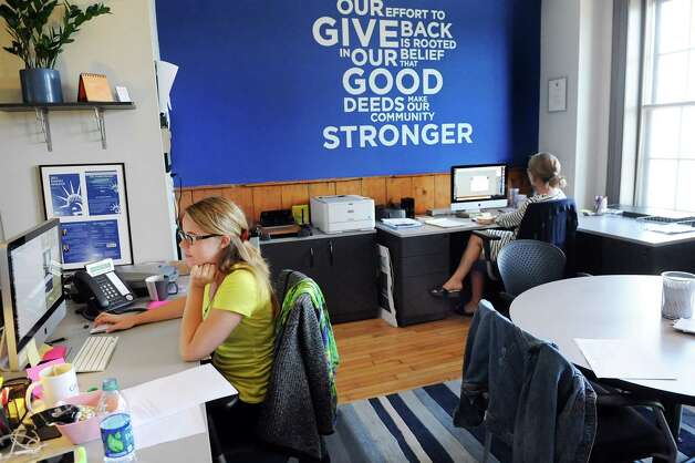 Chelsea McGuigan, operations coordinator, left, and Mia Ertas, creative director, work in their offices on Wednesday, Sept. 3, 2014, at Gramercy Communications in Troy, N.Y. (Cindy Schultz / Times Union) Photo: Cindy Schultz / 00028425A