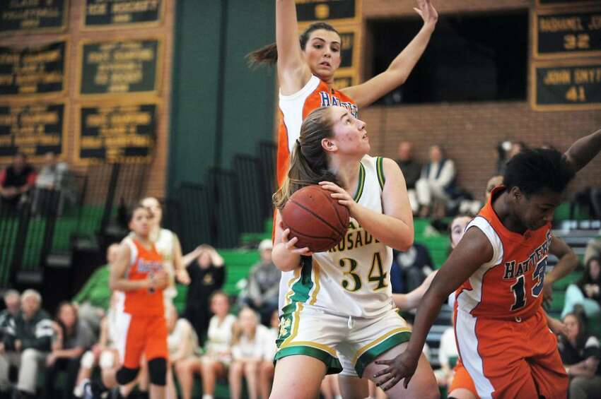 Trinity Catholic's Eileen Ornousky looks to take a shot against Danbury in the quarterfinals of the FCIAC girls basketball championship in Stamford, Conn. on Saturday, Feb. 20, 2010.