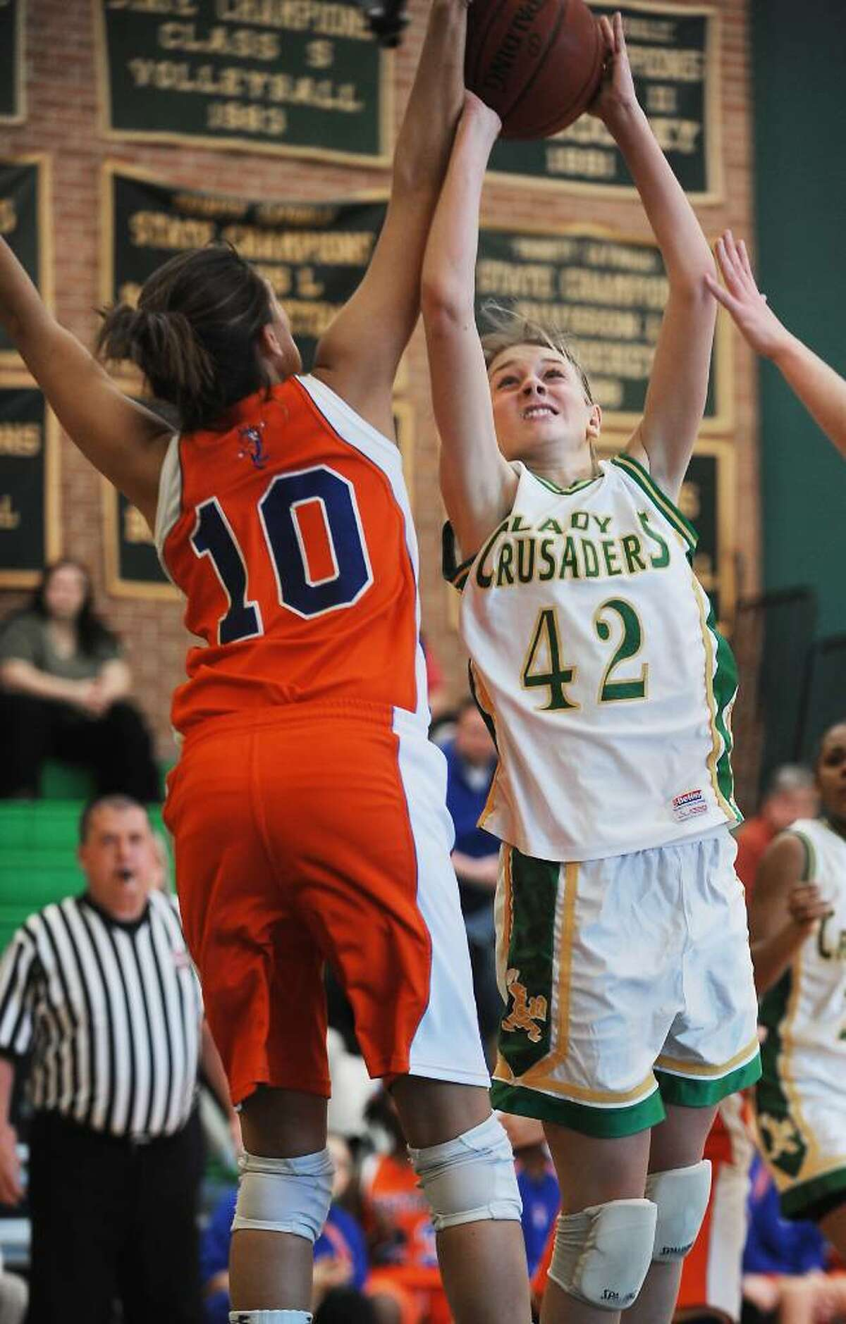 Trinity Catholic's Mackenzie Griffin goes up for a shot against Danbury's Casey Smith in the quarterfinals of the FCIAC girls basketball championship in Stamford, Conn. on Saturday, Feb. 20, 2010.