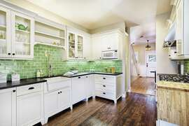 "Kelly Green  What might have been a pretty traditional black-and-cream kitchen gets a welcome burst of brightness with a backsplash in a happy hue called ""kelp.""    Project completed by  Fireclay Tile        Go Retro with These Cool Kitchen Gadgets   9 Common Hair Myths- Busted!   8 Stylish Tricks To Dress Up Your Coffee Table   11 Innovative Ways To Repurpose Old Clothes   19 Smart Solutions For Around The House   8 Clever Tricks To Keep Houseplants Happy"