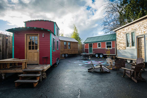 Caravan, The Tiny House Hotel  One of the most innovative and coolest hotels we've ever seen is situatedin an unassuming lot in northeast Portland, Oregon:  Caravan , the Tiny House Hotel, claims to be the first of its kind in the U.S., and is making waves among followers of the  tiny house movement . For $125 a night, you can stay in one of the property's six tiny houses, each built on wheels and outfitted with a bathroom, kitchen, and sleeping loft.      50 Best Ways To Use Mason Jars   The 22 Most Incredible Old Houses in Movies   13 Moonshine Recipes You Need To Make Now   The Best Paint Colors Right Now   12 Design Ideas For A Colorful Retro Kitchen   The 23 Best Ways To Use Lavender