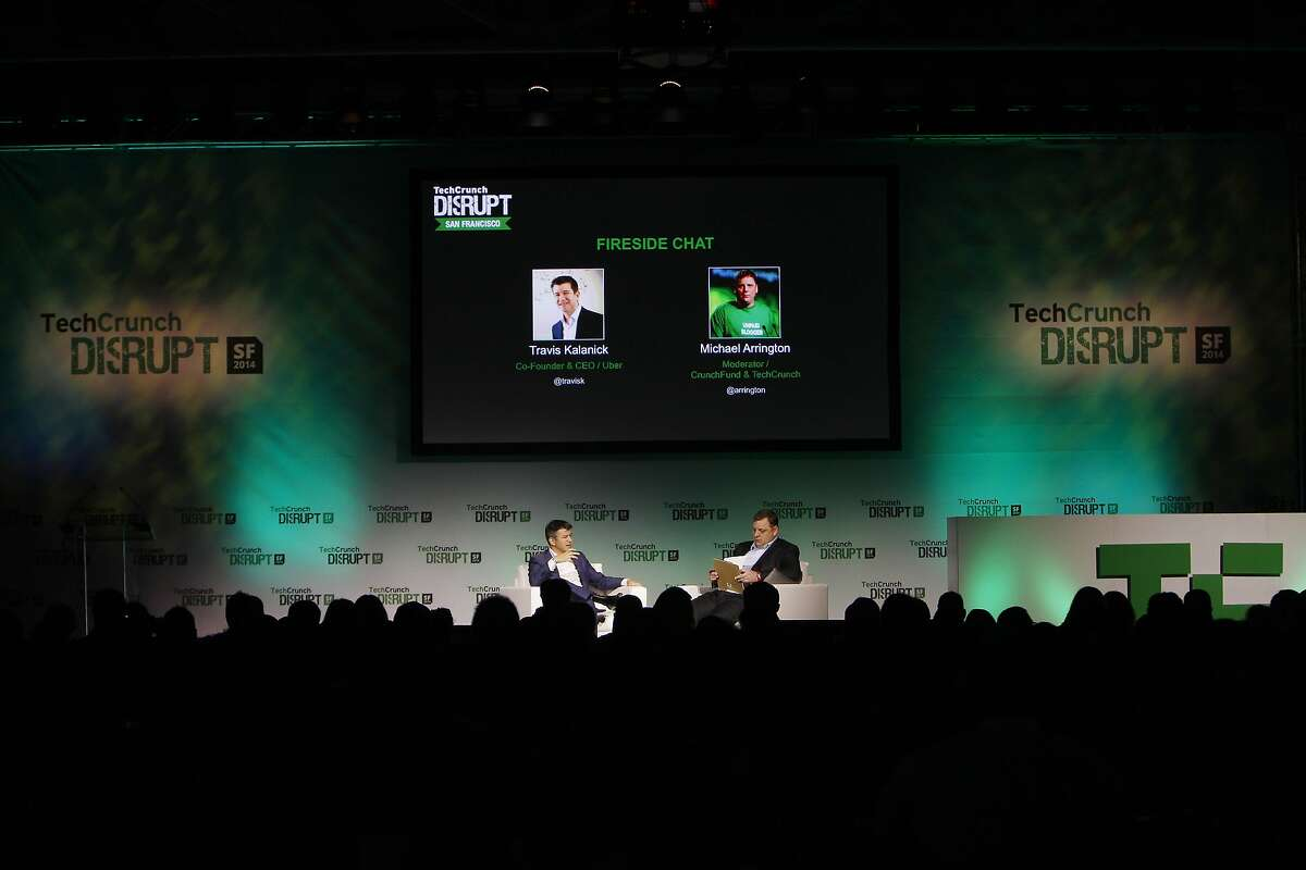 Travis Kalanick (l to r), Uber co-founder and CEO and Michael Arrington TechCrunch founder talk during a fireside chat at TechCrunch Disrupt SF on Monday, September 8, 2014 in San Francisco, Calif.