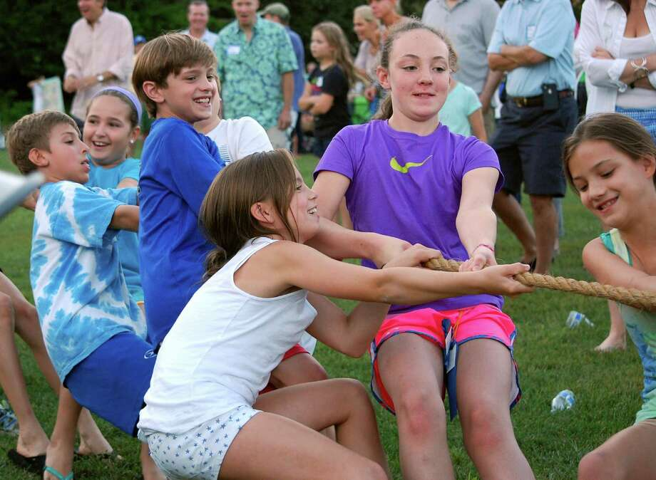 Ox Ridge fifth graders, from left, Matthew Magnotta, Charly Covello, Austin Peck, Lily Tarrant, Ava Tucci and Sophie Petti tackle the tug-of-war at the annual Ox Ridge Family picnic. Photo: Contributed Photo, Contributed / Darien News Contributed