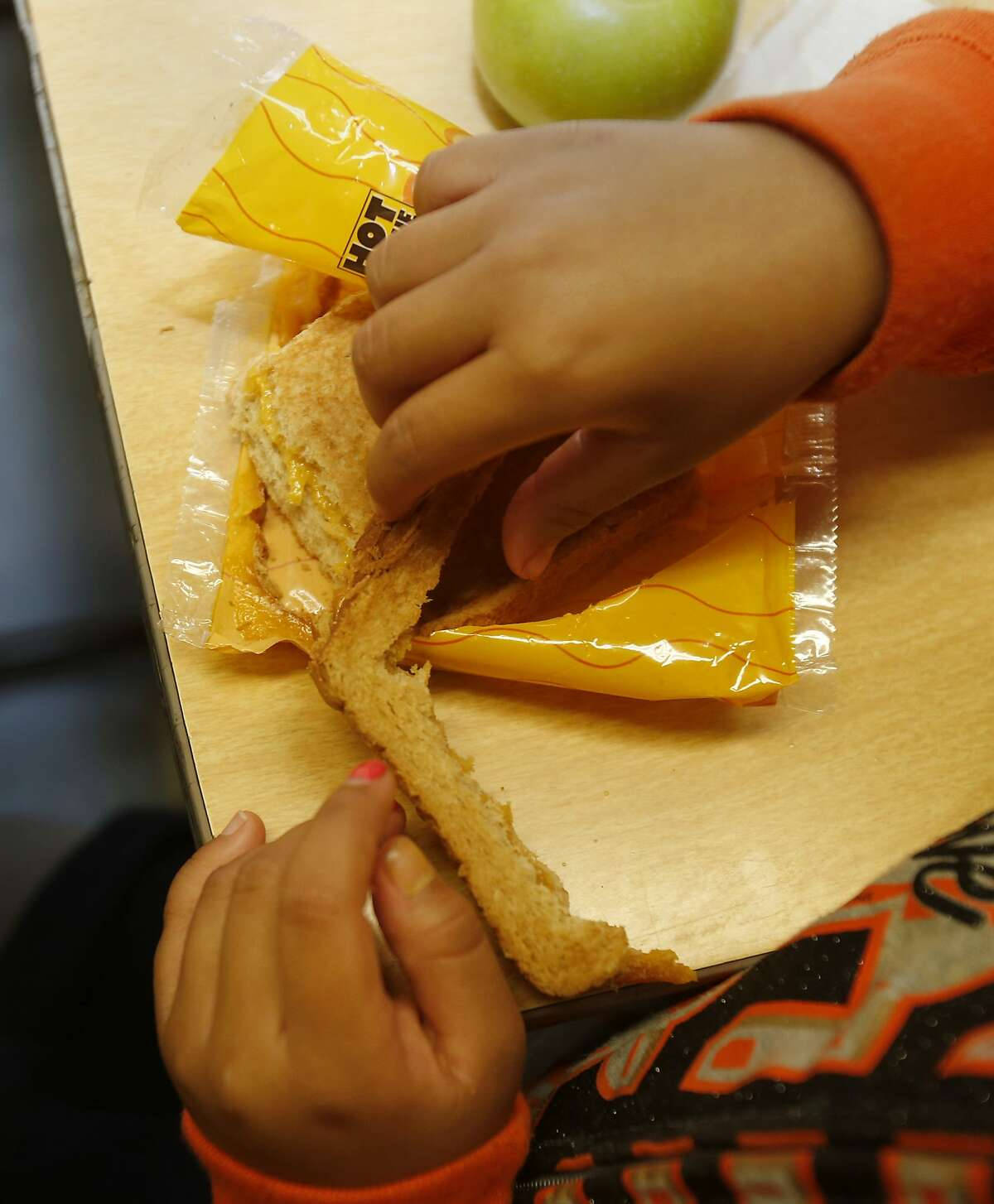 One student removed the crust as she ate her grilled cheese sandwich Monday September 8, 2014 at Spruce School in South San Francisco, Calif. Some Bay Area schools are beginning to offer meatless lunches for their students, among them is Spruce School in South San Francisco.