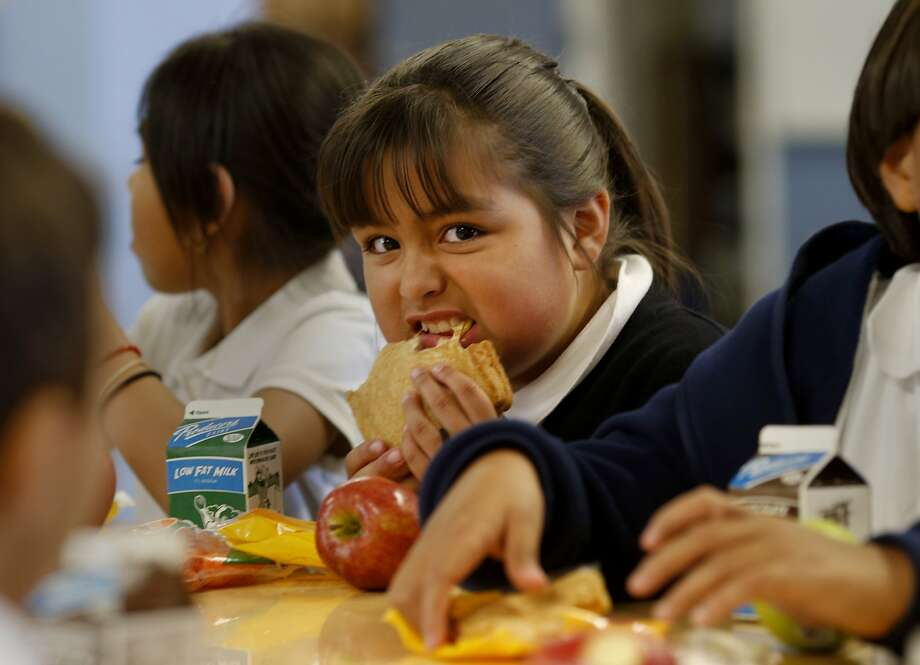 Third-grader Deanna Soto eats a grilled cheese sandwich at Spruce School in South San Francisco. Photo: Brant Ward, The Chronicle