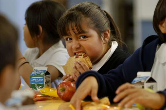 Third grader Deanna Soto (center) ate her grilled cheese sandwich as part of her meatless lunch Monday September 8, 2014 at Spruce School. Some Bay Area schools are beginning to offer meatless lunches for their students, among them is Spruce School in South San Francisco.